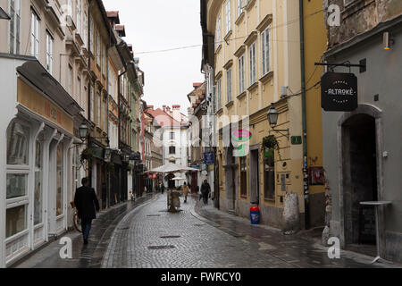 Mestni trg, a street in the heart of the Old Town of Ljubljana, Slovenia. Historic buildings overlook the cobbled - Stock Photo