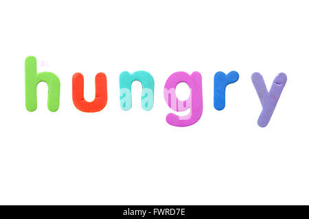 The word hungry created form alphabet fridge magnets photographed against a white background. - Stock Photo
