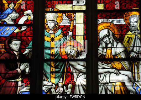 Detail from stained glass window in cathedral in Beaune, France - Stock Photo