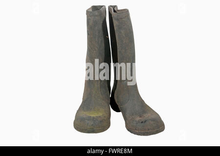 Isolated pair of old neglected dirty black wellington boots on white - Stock Photo