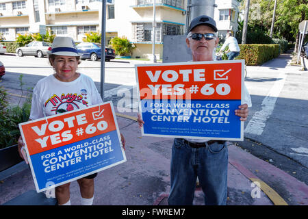 Florida FL Miami Beach primary voting vote election polling place campaigning local issue Hispanic man woman - Stock Photo