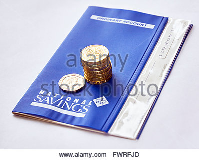 NS&I National Savings and Investments a state-owned savings bank in the UK with seven british pound coins and 20 - Stock Photo