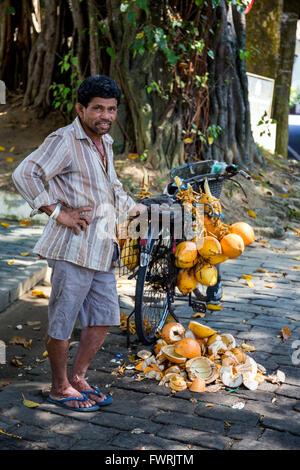 coconut vendor in Fort Galle, Sri Lanka, Asia - Stock Photo