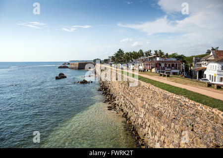 Galle Fort, listed as World heritage by UNESCO, old colonial houses behind the sea side walls of the fortified town, - Stock Photo