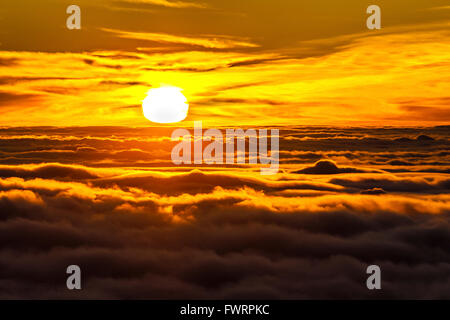 spectacular sunrise with view over the clouds from Haleakala crater on Maui - Stock Photo
