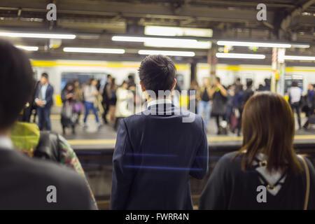 Passengers traveling by Tokyo metro. - Stock Photo