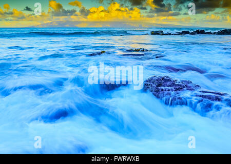 sunrise over Molokai viewed from Maui Hawaii - Stock Photo
