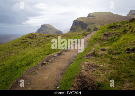 A dirt path leading through the Quiraing on the Isle of Skye in Scotland - Stock Photo
