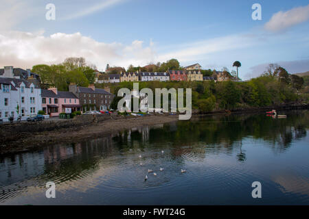A sunny view of Portree, the largest town on Scotland's Isle of Skye. - Stock Photo