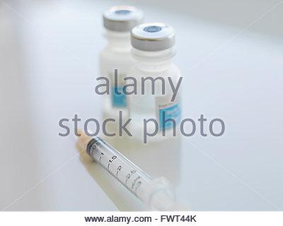 Syringe and insulin bottles on white background - Stock Photo