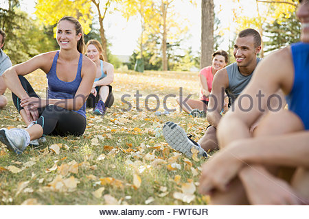 People resting after outdoor fitness class. - Stock Photo