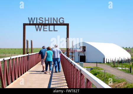 Visitors walk along the viewing area over various animal habitats at The Wild Animal Sanctuary. - Stock Photo