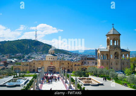Tourists visiting  the Holy Trinity Cathedral of Tbilisi, commonly known as Sameba. - Stock Photo