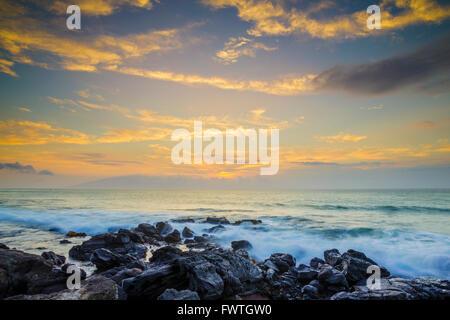 Lanai sunset seen from Maui - Stock Photo