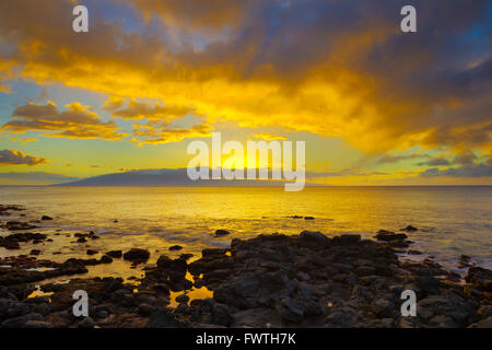 Lanai at sunset seen from Maui - Stock Photo