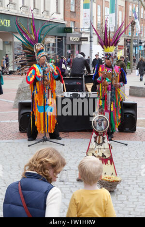 Mother and child listening to Peruvian south american buskers street music, Broad Street, Reading Berkshire UK - Stock Photo