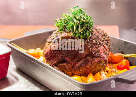 Gourmet Main Entree Course Grilled Rib-Eye Beef steak with herb - Stock Photo