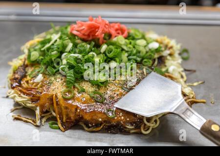 okonomiyaki japanese pizza hiroshima style - Stock Photo