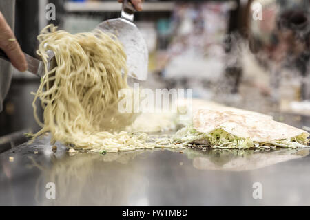 cooking of okonomiyaki japanese pizza - Stock Photo