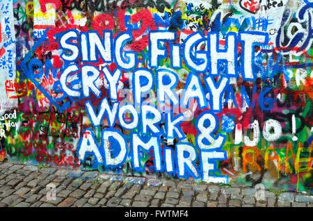 Prague, Czech Republic. The 'John Lennon Wall' in Velkoprevorské námestí - magnet for graffiti writers since the - Stock Photo
