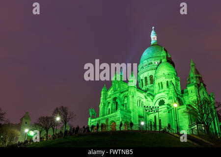 The Basilica of Sacre Coeur in Montmartre, Paris at night - Stock Photo