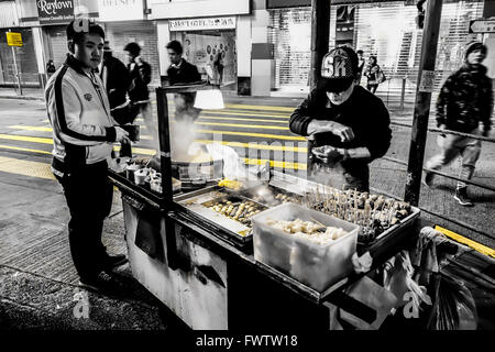 Fast food on the night streets of Hong Kong - Stock Photo
