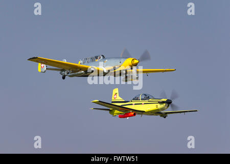 "Farner Werke (F+W) C-3605 ""Schlepp"" Swiss target towing aircraft HB-RDB in formation with a Swiss Air Force PC-7 - Stock Photo"