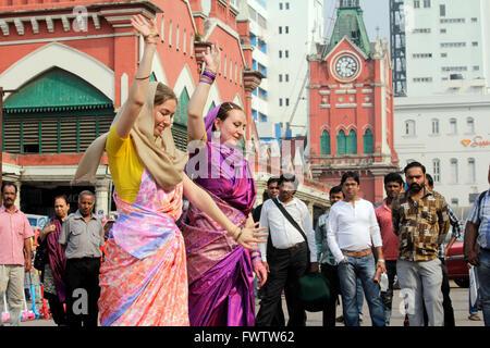ISKCON devotees belonging to Russia performing bhajan on the streets of Kolkata - Stock Photo