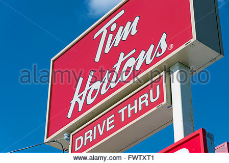 Tim Horton's drive through sign: Tim Horton is known all over Canada for serving hot and delicious coffee specially - Stock Photo