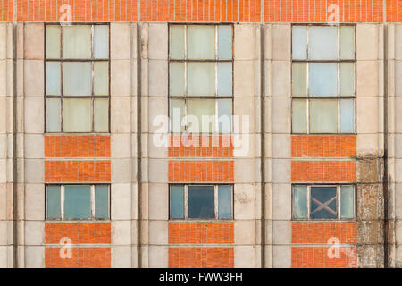 Several windows in row on facade of industrial building front view, St. Petersburg, Russia - Stock Photo