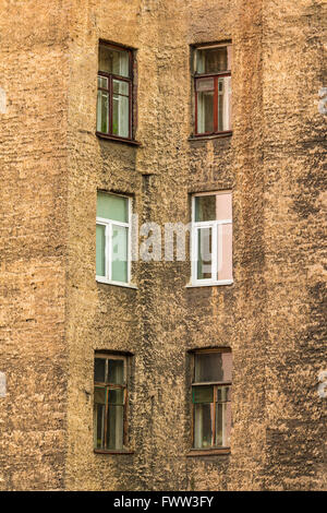 Several windows in row on facade of urban apartment building angle view, St. Petersburg, Russia - Stock Photo