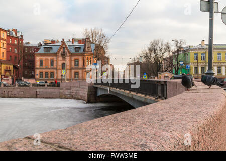 St. Petersburg, Russia - March 10, 2016: View of the Moyka River and bridge from the embankment. - Stock Photo