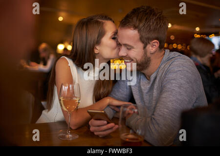 Romantic Couple Sitting And Talking In Wine Bar Together - Stock Photo