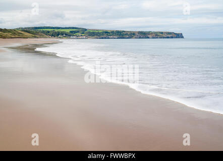 View towards Sandsend  from Whitby beach. Whitby, North Yorkshire, England, UK - Stock Photo