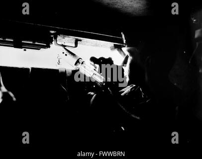 Northern Ireland 1984 - A soldier from the Queen's Regiment on patrol inside an armoured vehicle known as a 'pig' - Stock Photo