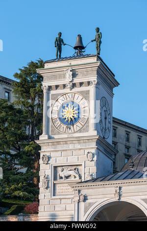 Clock tower of Loggia di San Giovanni, Torre dell'Orologio, Piazza Liberta, Udine, Friuli-Venezia Giulia, Italy - Stock Photo
