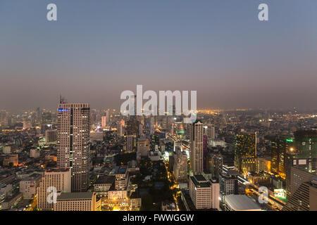 Panoramic view from the Sky Bar of Lebua State Tower on Bang Rak, Silom and Sathon district at dawn, Bangkok, Thailand - Stock Photo