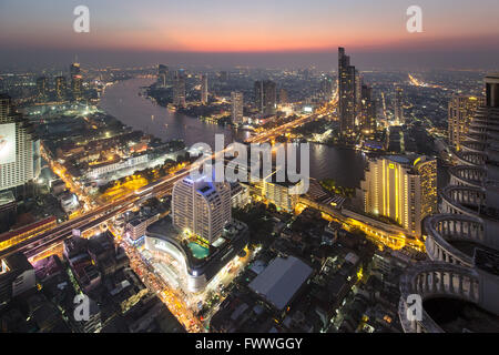 Panoramic view from the Sky Bar of the Lebua State Tower, Chao Phraya river, bridge to Khlong San district, dawn - Stock Photo