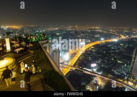 Guests at the Sky Bar on the Lebua State Tower with panoramic views, night shot, Bang Rak district, Bangkok, Thailand - Stock Photo