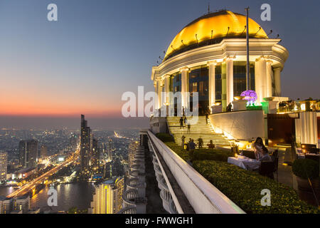 Sky Bar on the Lebua State Tower, panoramic views of the Chao Phraya River and the Khlong San district at dawn - Stock Photo