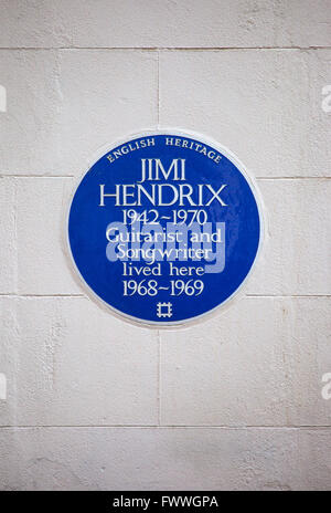 A blue plaque marking the location where iconic guitarist Jimi Hendrix once lived in central London, England. - Stock Photo