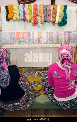 Carpet weaving in Turkey - Stock Photo