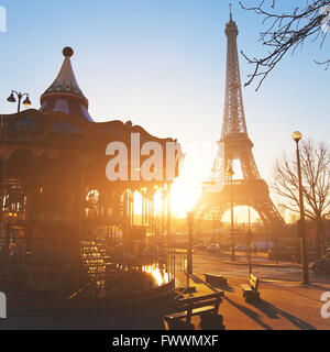 carousel at Eiffel tower in Paris, sunny day, France - Stock Photo