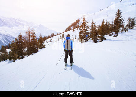 skiing in Alps, winter sport in mountains, skier and beautiful landscape - Stock Photo