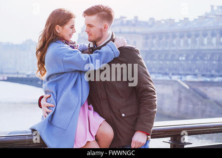 young happy couple looking to each other, spring fashion portrait - Stock Photo