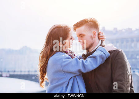affectionate couple, portrait of young happy man and woman, love in the city - Stock Photo