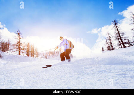 skiing downhill in winter mountains - Stock Photo