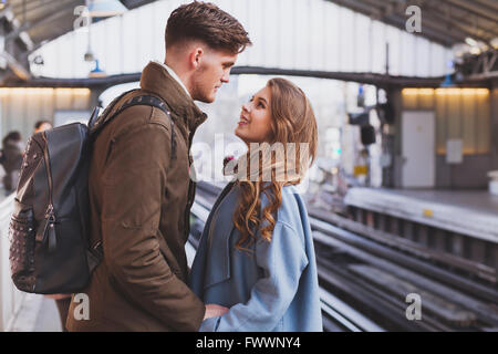 long distance relationship, couple on platform at the train station, meeting or parting concept - Stock Photo