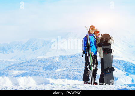 winter sports, happy young family at ski holidays - Stock Photo