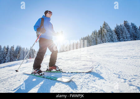 ski in Alps, winter sport, young skier on the slope in sunny day - Stock Photo
